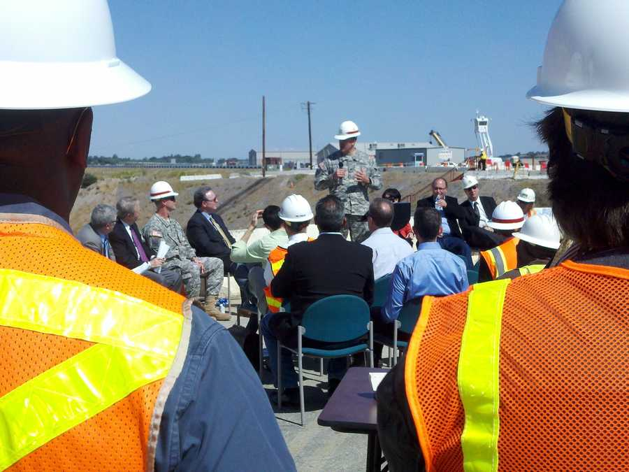 A ceremony is held at Folsom Lake Thursday, marking a construction milestone for the Folsom Dam flood-control project.
