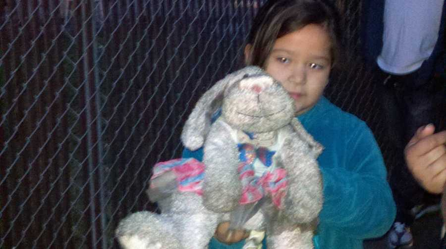 One girl clutches a slightly charred stuffed animal she rescued from her home.
