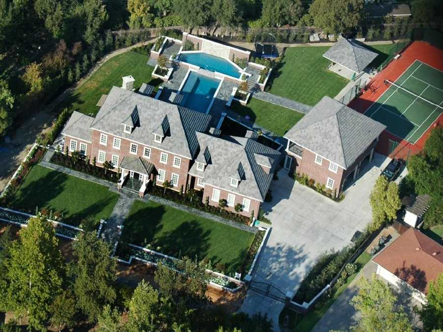 Home No. 5: Brick colonial in Sacramento. This aerial shows the home's features which include a large pool, a guest home and a tennis court.
