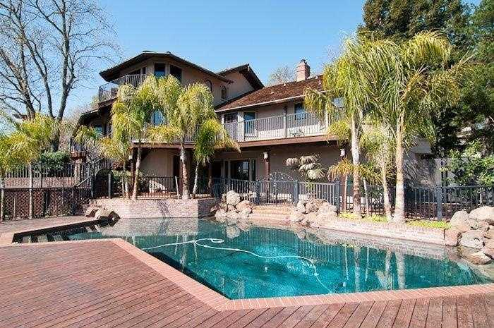 The pond-like pool has a lower deck area with views of the American River.