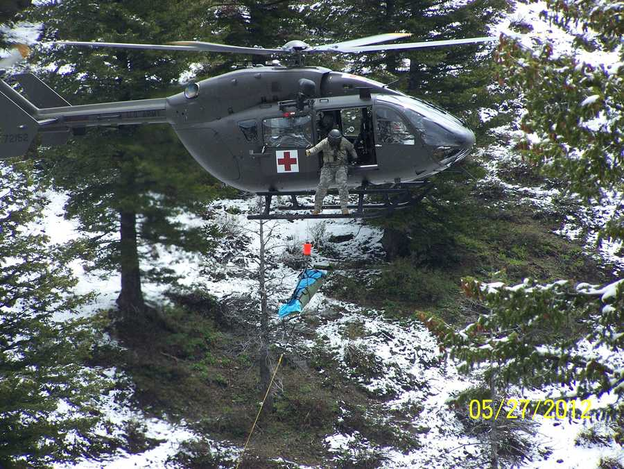 A medical helicopter was turned away by snow showers. The National Guard sent in this crew to rescue the crash victims.
