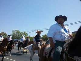 A parade in North Highlands features men on horses.
