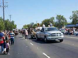 A procession makes its way through a parade in North Highlands on Monday.