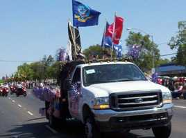A truck stocked with flags participates in a North Highlands parade Monday.