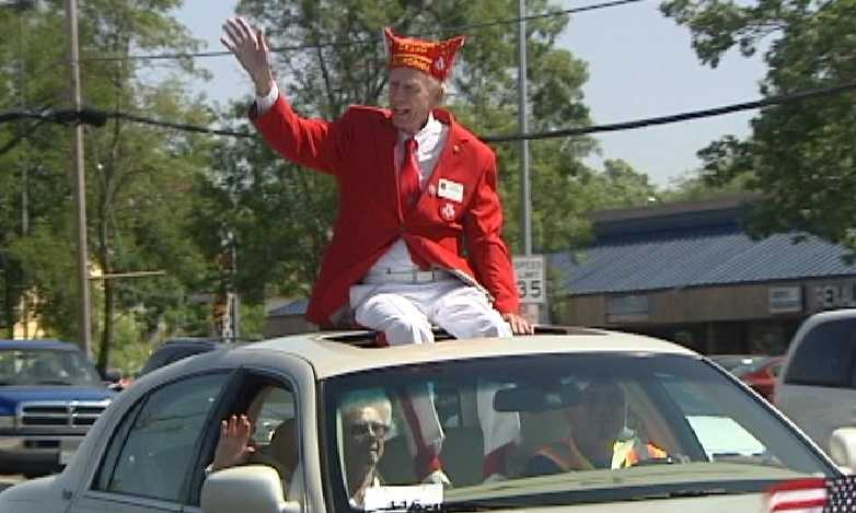 A man waves from atop a car during a Memorial Day parade in North Highlands on Monday.