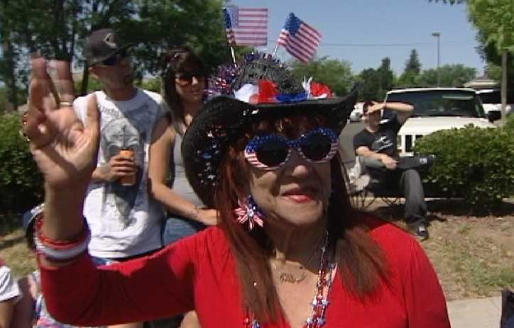 A woman waves during a Memorial Day parade in North Highlands on Monday.