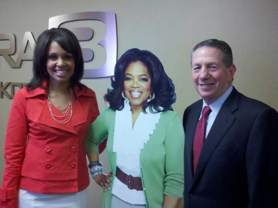 Adrienne and Elliott Troshinsky, KCRA-KQCA general manager, stand next to Oprah (a cardboard cutout).