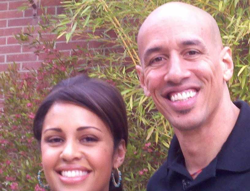Adrienne stands next to former Sacramento King Doug Christie.