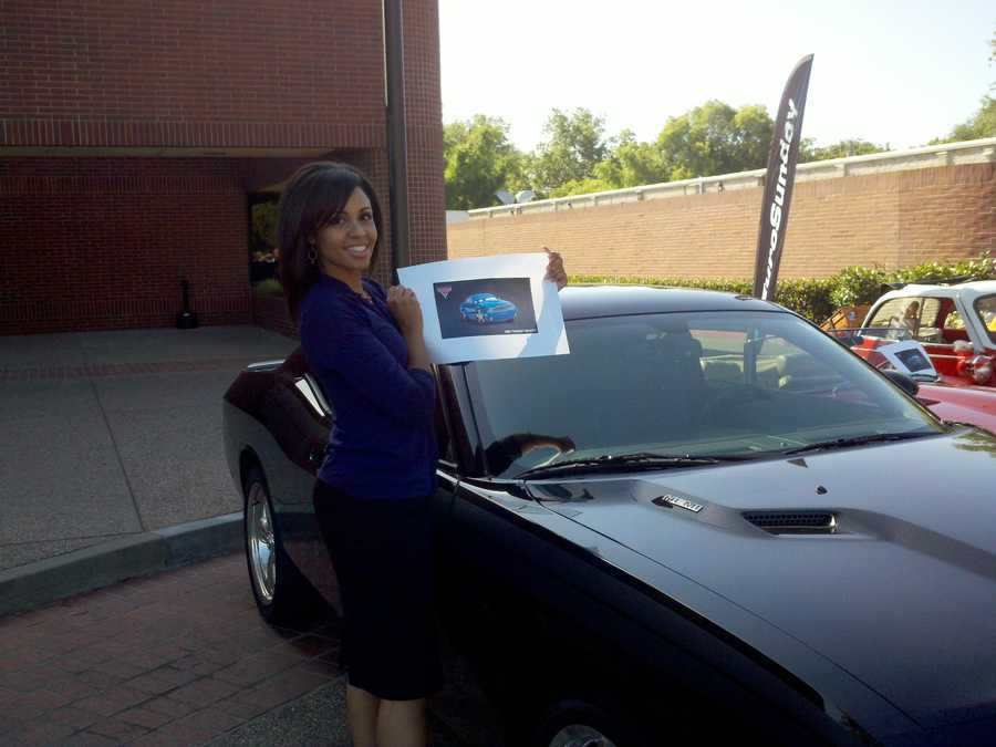 Adrienne stands next to a car outside the KCRA 3 news station.
