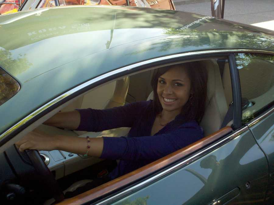 Adrienne gets behind the wheel in this car.
