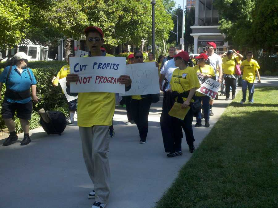 Advocates for individuals with disabilities rally outside the west steps of the state Capitol on Wednesday.