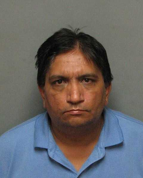 """Gurminder """"Gary"""" Parmar, a liqour store owner, was arrested after police said he opened fire on a 21-year-old man inside his shop. Read full story"""