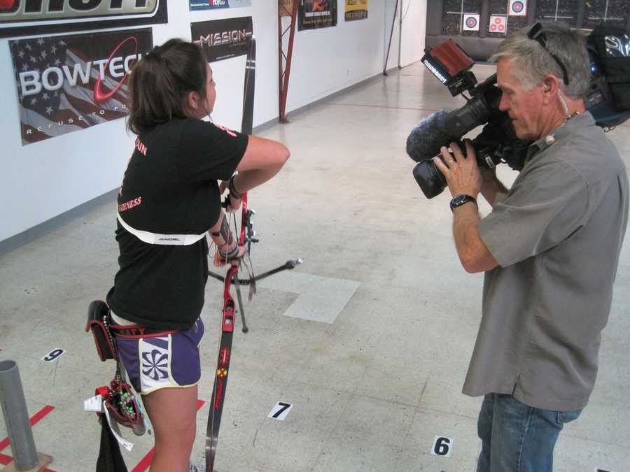 Photographer Mike Rhinehart shoots the shooter, Junior Olympian Katie Alexander.