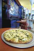The Pescadero County Store is a casual establishment best known for its delectable pizzas, baked in an impressive wood-fired oven.