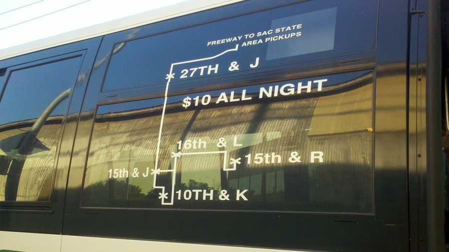A map on the side of the bus shows stops in downtown Sacramento and near off-campus housing.