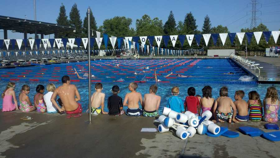 Thousands of people jumped in pools across the country Thursday morning in an attempt to break a Guinness World Record for the largest swimming lesson. One took place at Roseville Aquatics.