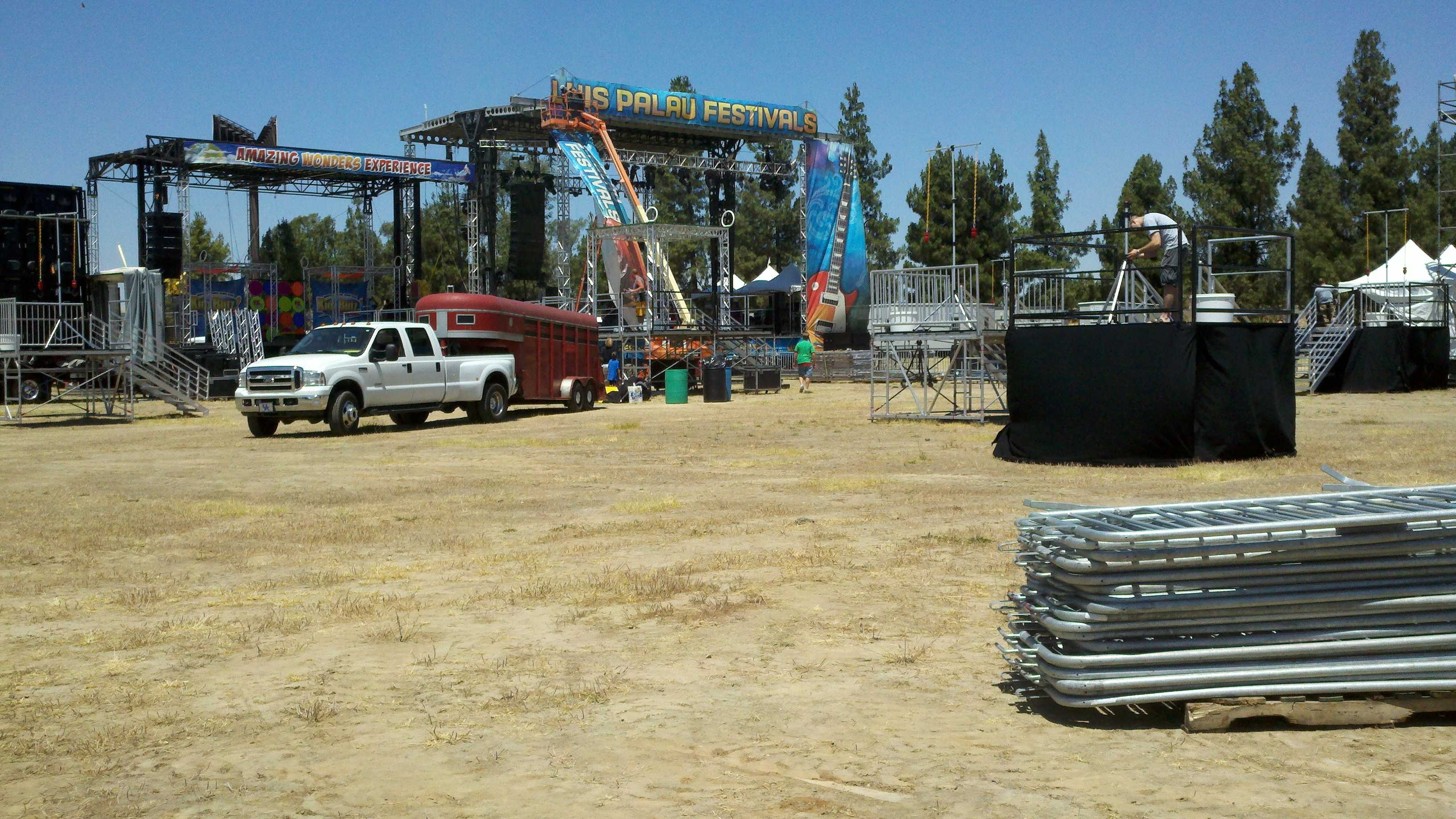 Crews assemble a stage for the Palau festival.