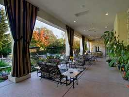 The home has this covered patio, perfect for lounging and entertaining guests.