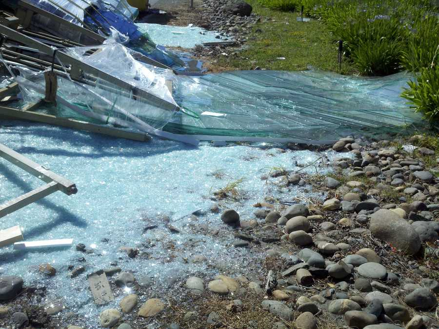 A big rig overturned in West Sacramento on Tuesday, temporarily blocking traffic. The truck was carrying window panes, and glass shattered onto the roadway when the vehicle overturned (June 19, 2012).