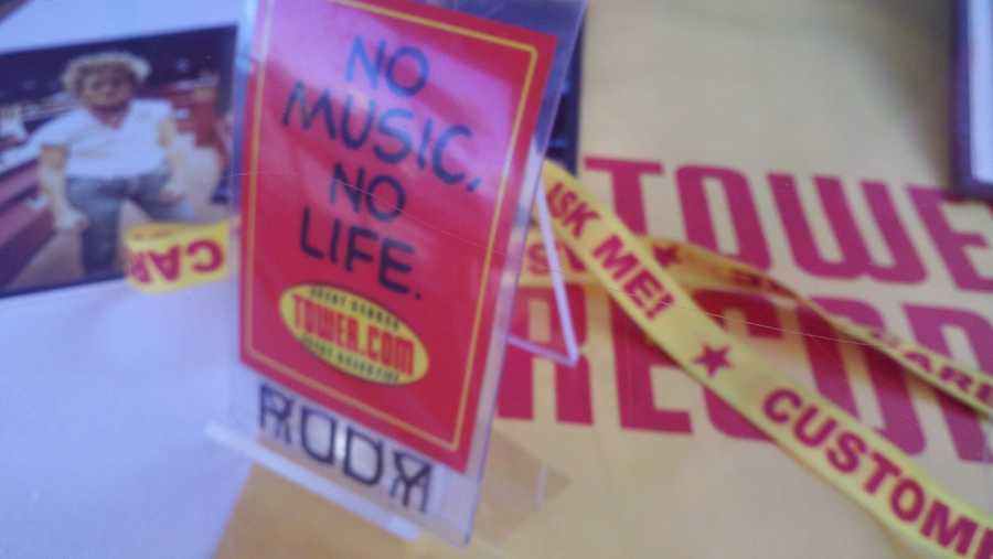An employee badge from Tower Records.