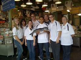 Visit to Pike Market in Seattle&#x3B; from left to right:First row: Brooklyn Omstead, Emily Cornelison, Julian De Los Santos, Sean Ferguson, Kathy SadySecond row: Dr. Maria Garcia-Sheets, Andrew Walter, Fish Market representative
