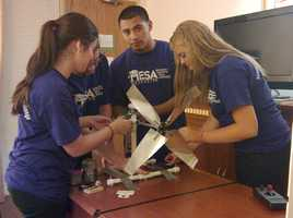 Device prep before competition begins Thursday, June 21st&#x3B; from left to right:Emily Cornelison, Sean Ferguson, Julian De Los Santos, Brooklyn Omstead