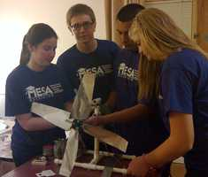 Device prep before competition begins&#x3B; from left to right:Emily Cornelison, Sean Ferguson, Julian De Los Santos, Brooklyn Omstead