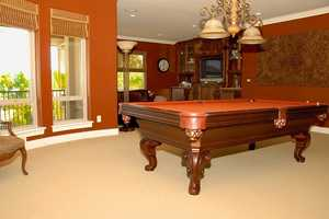 This home also has this entertainment room, complete with a billiard table.