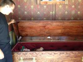 """The """"buried alive"""" simulator allowsfair-goersto experience the feeling of being enclosed in a coffin."""