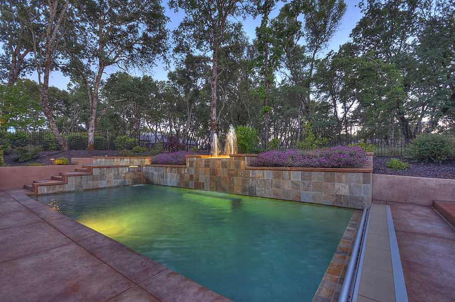 Here's a closer look at the home's large sunny swimmer's pool.