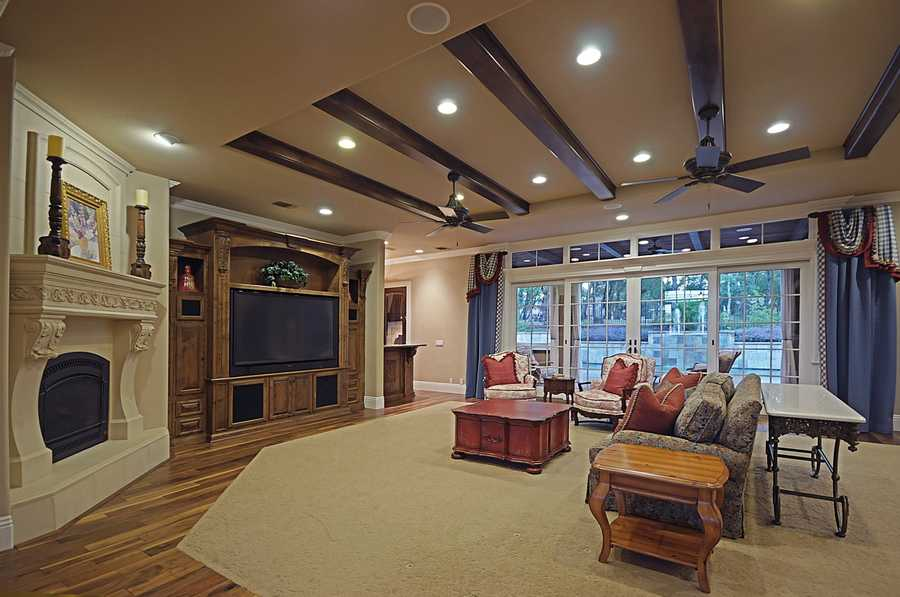 Here's a view inside the living room, which includes walnut hand scraped hardwood floors.