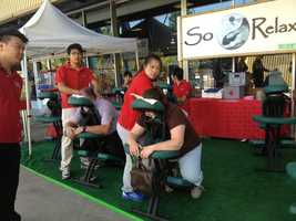 Fairgoers take a break from the sun with a massage from So Relax.