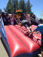 Gregory from Fresno climbs up the rope ladder in hopes of winning a prize.