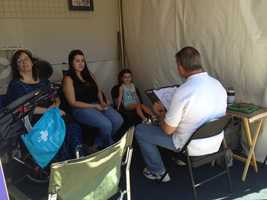Melanie Fowler, 4, patiently sits for a caricature.