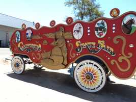 A California State Fair wagon can be seen on display.