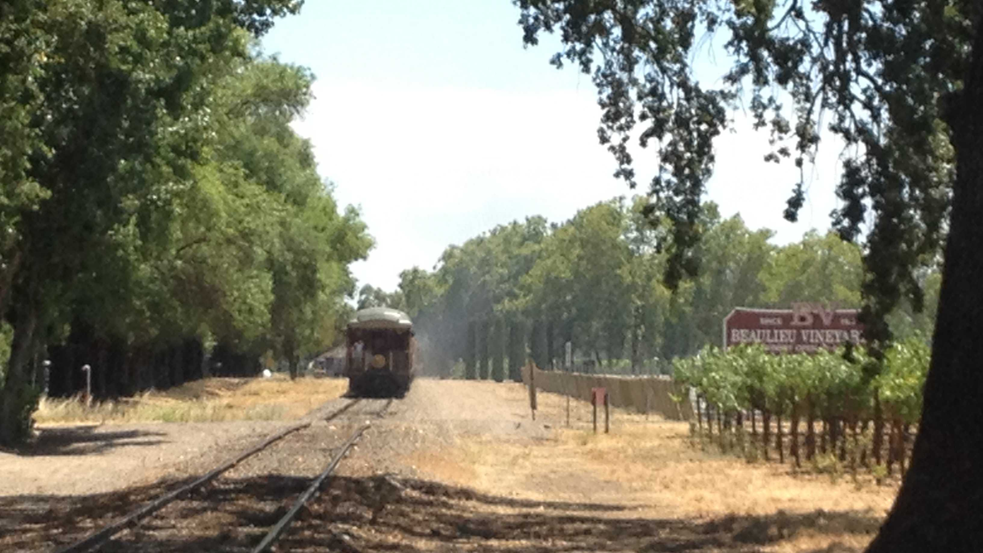 After dropping off passengers, the Napa Valley Wine Train heads back to Napa, passing Beaulieu Vineyard.