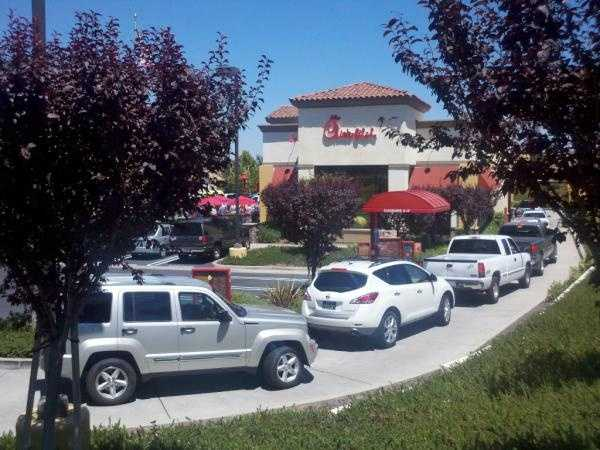 """Thousands gathered outside the Chick-fil-A restaurant in Roseville for what is called """"Chick-fil-A Appreciation Day""""."""