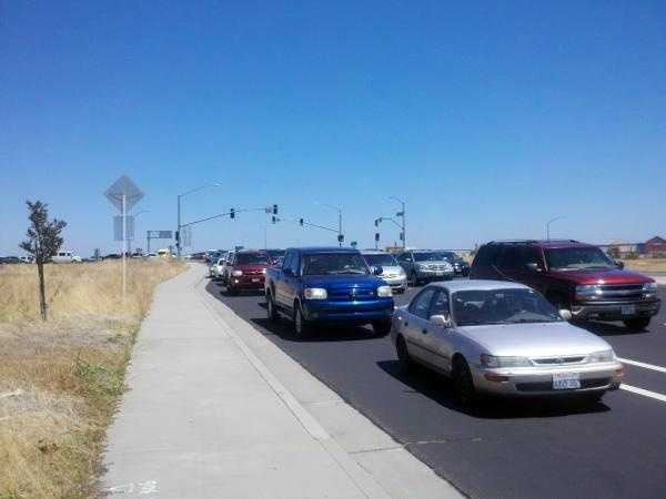 """Cars were backed up to Highway 65 outside a Chick-fil-A restaurant in Roseville on Wednesday as people gathered outside the restaurant for """"Chick-fil-A Appreciation Day."""""""