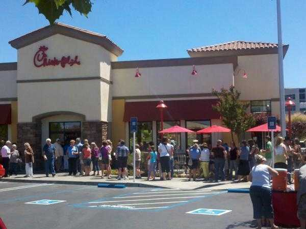 """Comments made last month by Chick-fil-A president Dan Cathy led to """"Chick-fil-A Appreciation Day"""" on Wednesday and Friday's """"National Same-Sex Kiss Day."""" See photos from across the country of both events."""