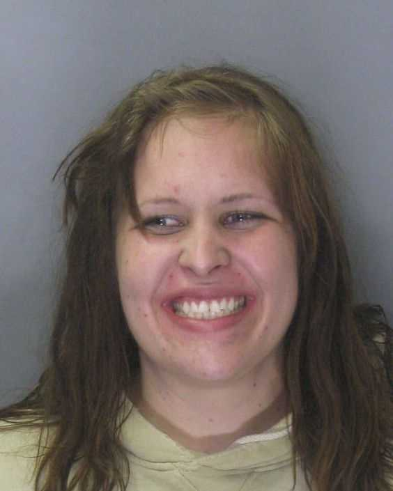 Maxine Schmidt, 21, was arrested on DUI and hit-and-run charges after crashing into a police car, police said.