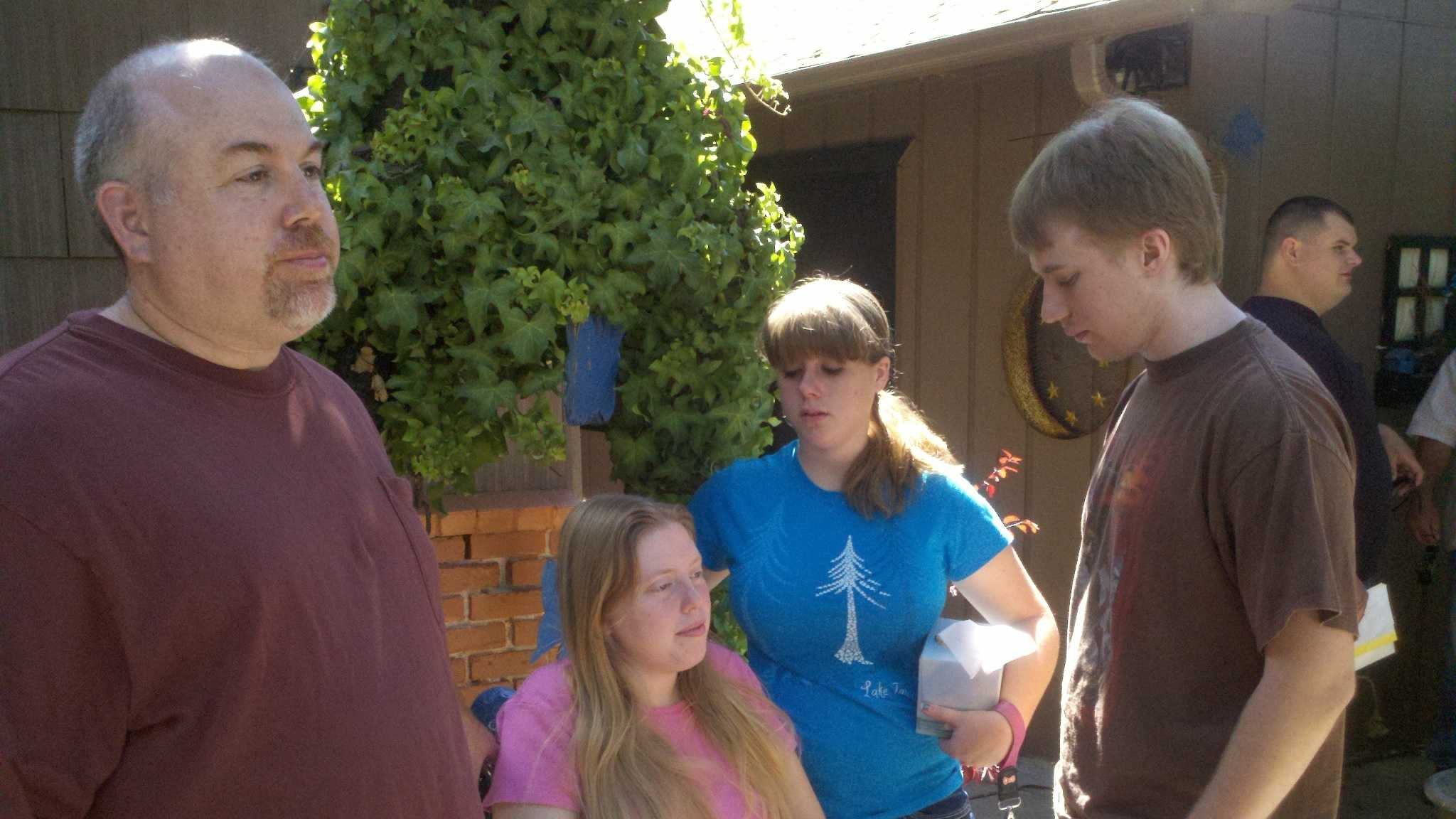West, seated, is next to her her niece and nephew. Her older brother, Trevor West, stands in the forefront. Walden was suspected of drinking and driving when he was arrested last month, three days after the fatal hit-and-run crash. Authorities said by time they made the arrest, it was too late to determine whether he was driving under the influence in the crash that led to Long-Randall's death.