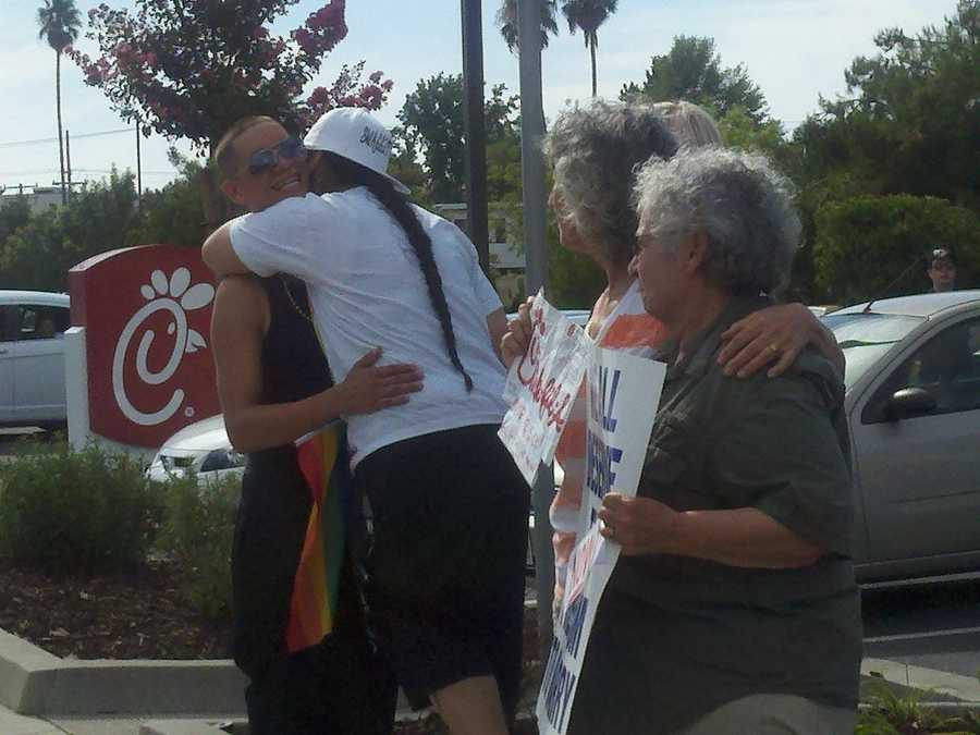 """Supports of an event dubbed as """"National Same-Sex Kiss Day"""" stood outside the Chick-fil-A at Arden Way in Sacramento on Friday."""