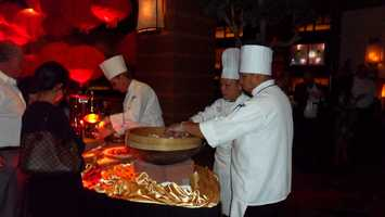 Chefs in the Red Lantern preparing authentic Asian noodles.