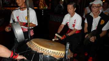 Taiko drummers help to set the mood at the Red Lantern opening.