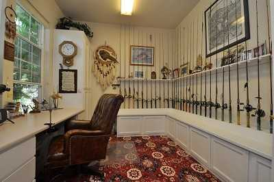 Thisspacioushome also includes this hobby room.