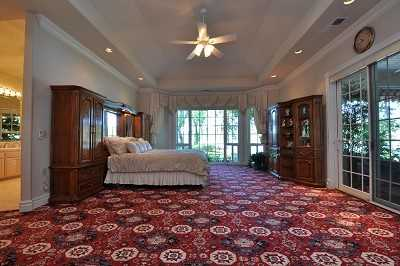 Each of the four bedrooms contains en suite baths, including this master suite.