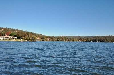 This home offers this lakefront view, with easy access to private golfing, boating, water skiing and clubhouse.