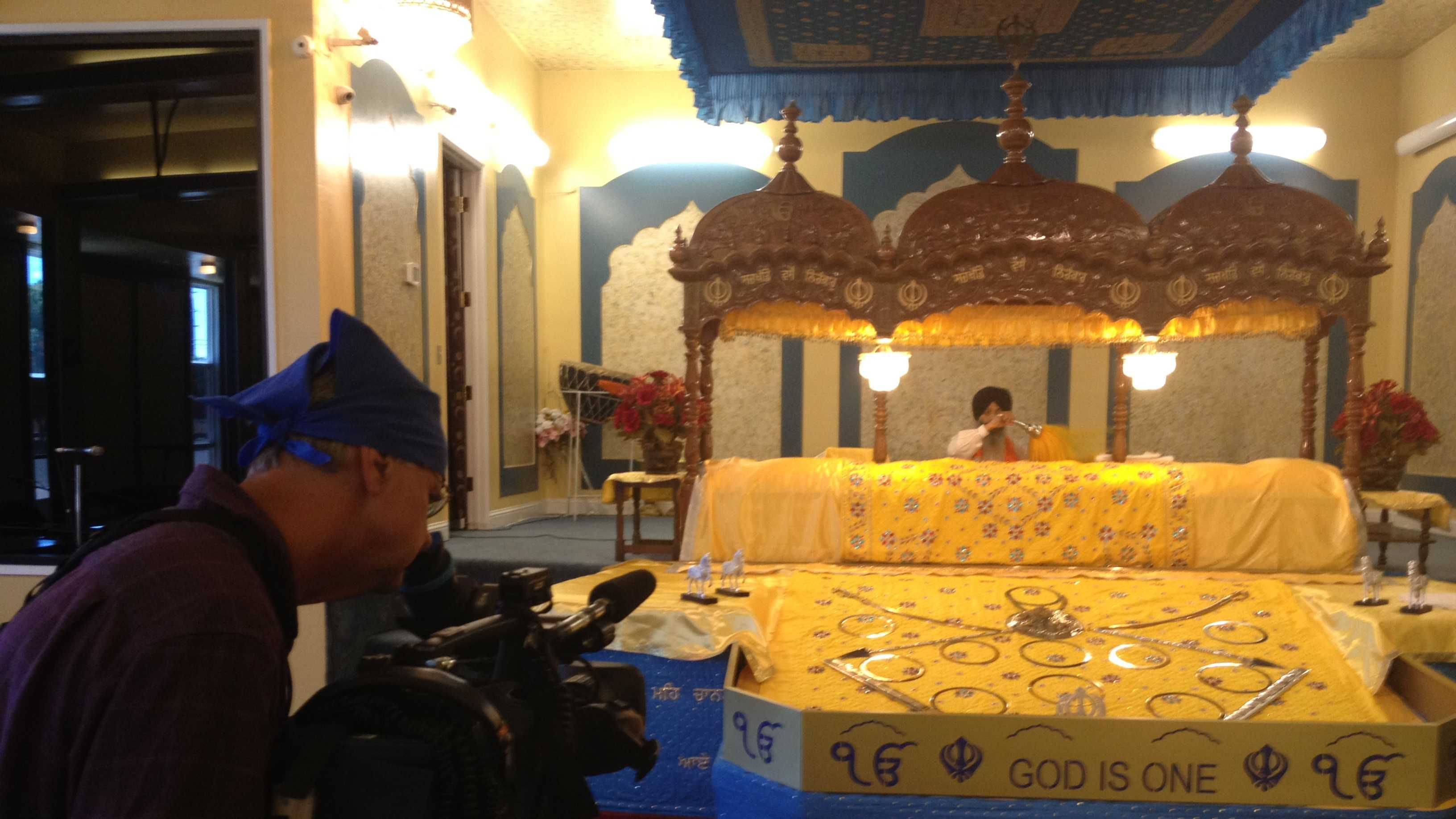 KCRA photographer John Breedlove shoots prayers and the altar inside the Yuba City Sikh temple