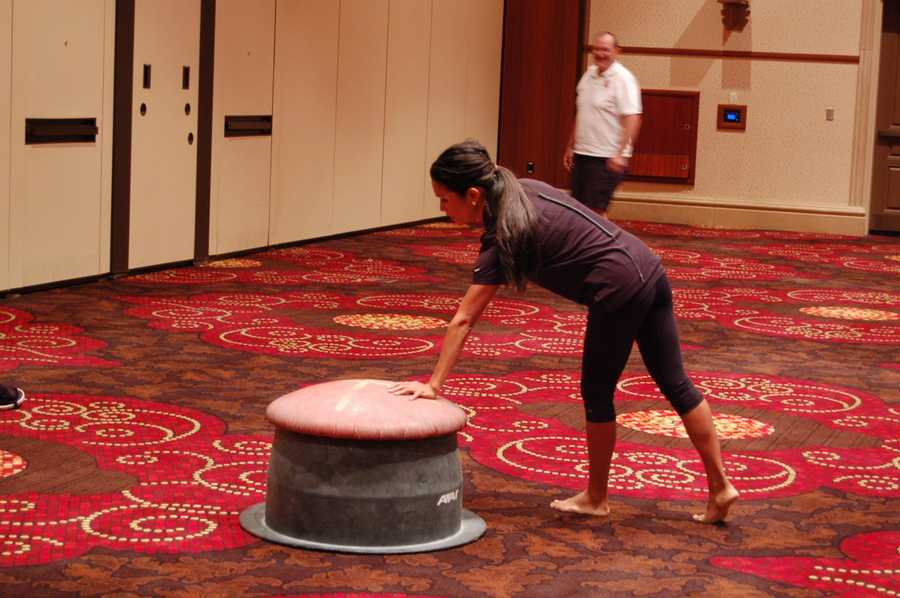 "Mae Fesai gives ""the mushroom"" a try in learning how to do many of the moves used in pommel horse."