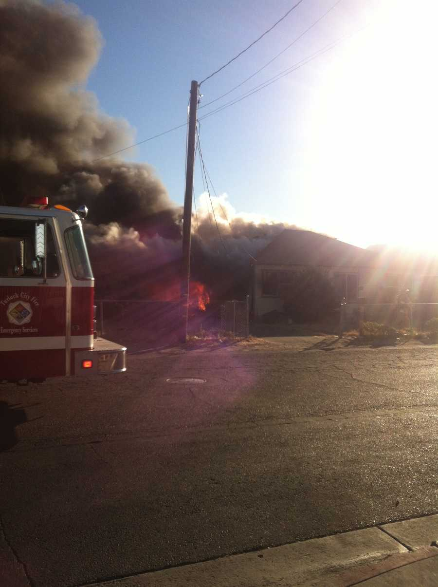 A Turlock house on Eighth Street became fully engulfed in flames Wednesday evening across from the Foster Farms Plant.